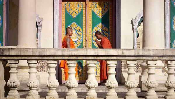 Cambodian monks are greeting each other