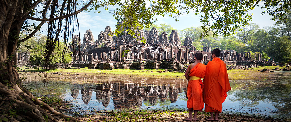 Cambodian Monks standing near a heritage
