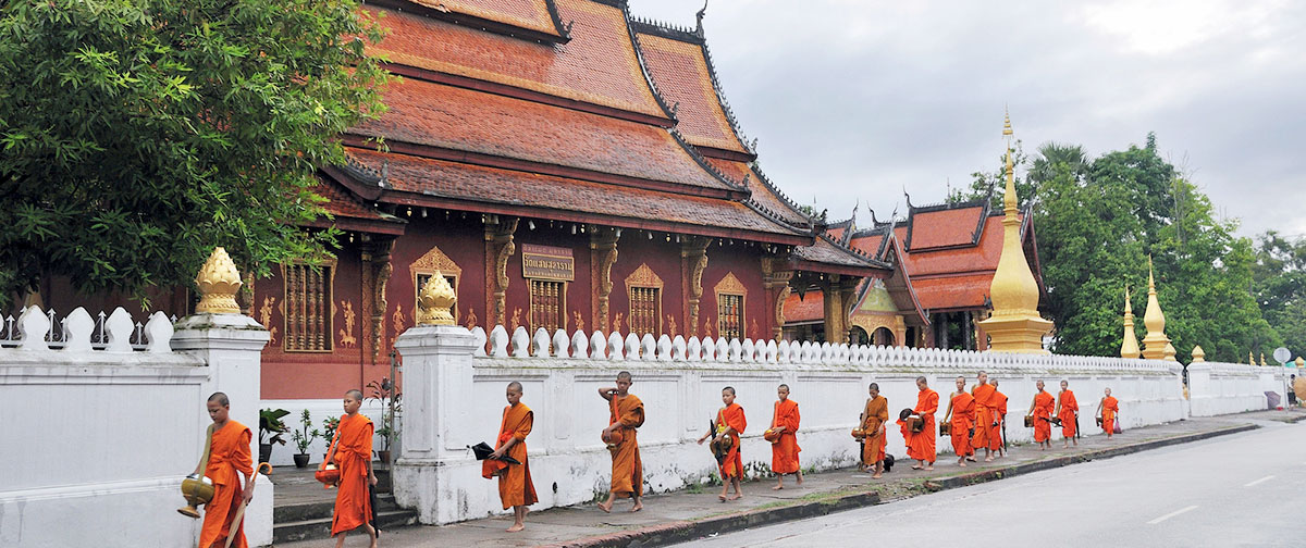 Monks are walking in Luang Prabang