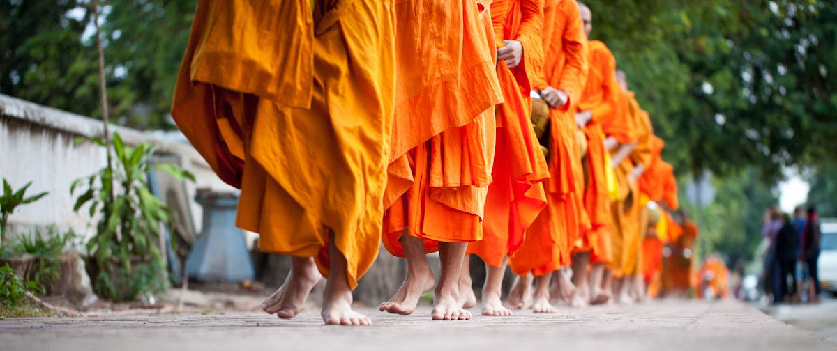 Follow the Laotian monks to receive alms